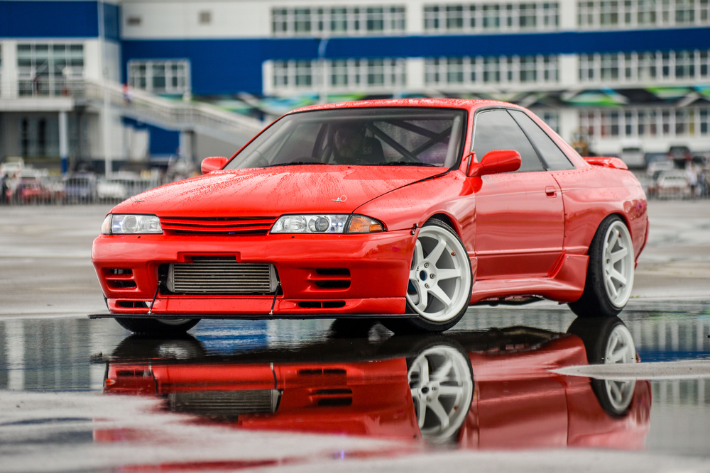 driver drives a Nissan skyline R 32 red, on pools 9 July 2016 in Khabarovsk, Russia