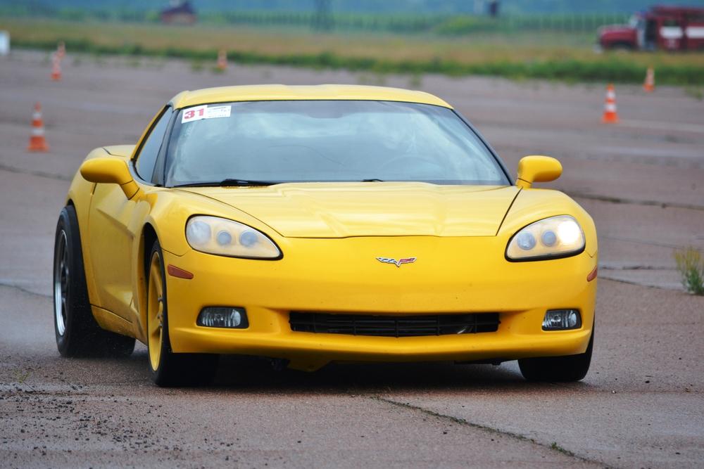 Yellow Chevrolet Corvette on racetrack