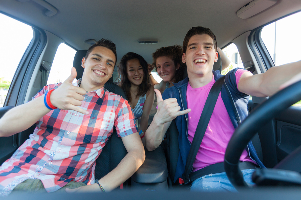 Four Friends in the Car Leaving for Vacation