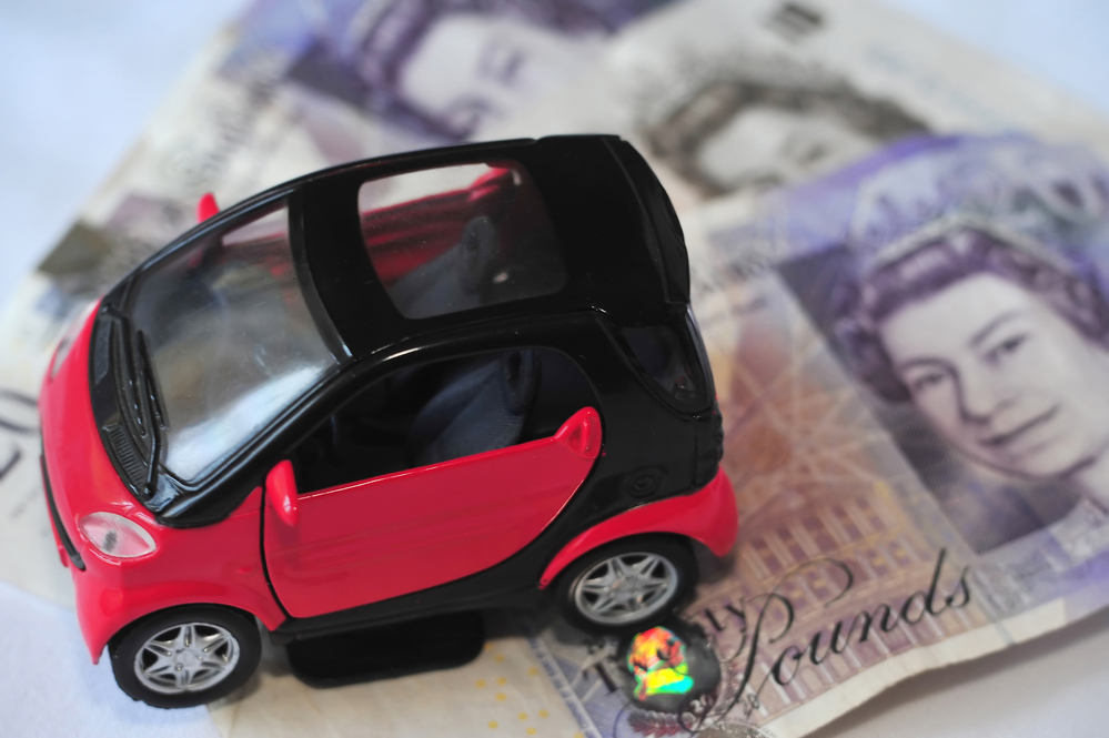 Toy smart car on British Pounds