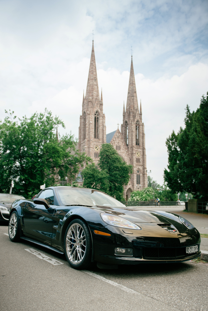 Chevrolet Corvette ZR 1 luxury sport car parked with St Paul church towers in background