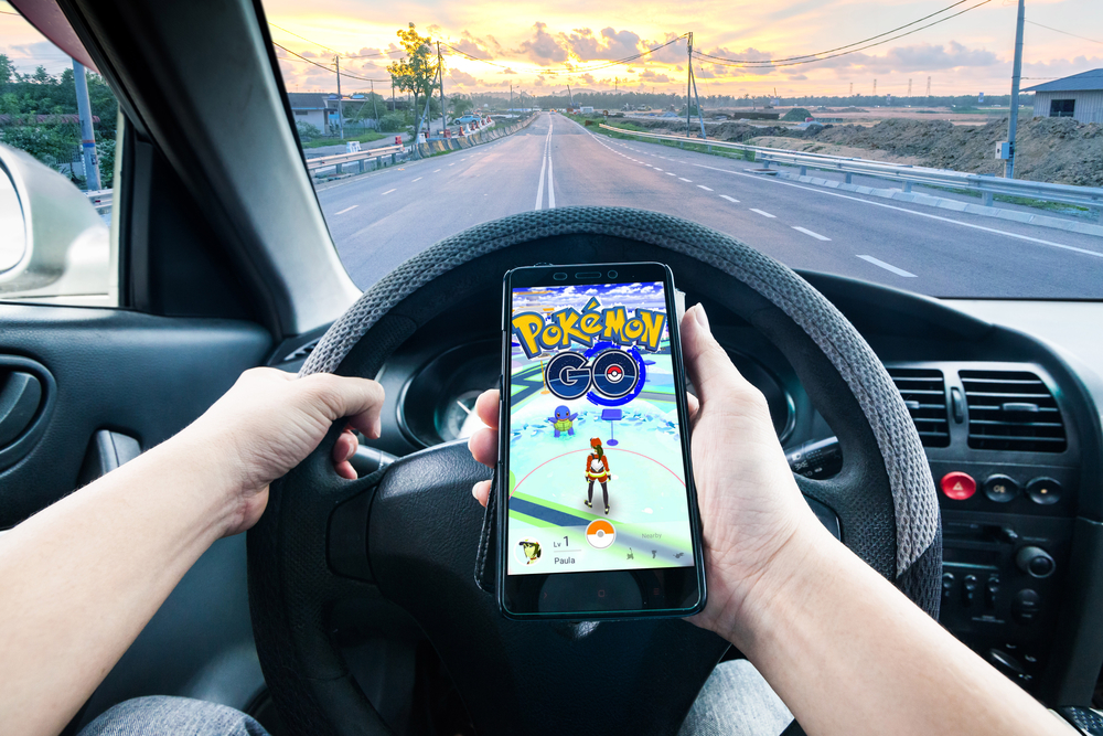 Hand holding a cellphone loading Pokemon Go