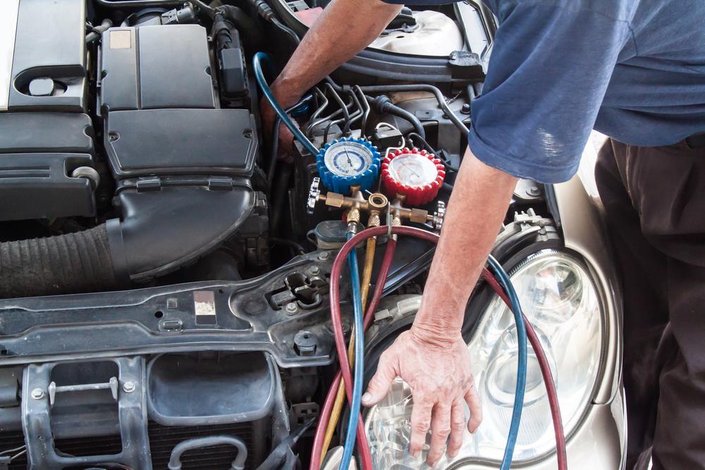 mechanic-inspecting-used-car