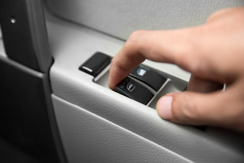 A portrait of windows controls and adjustments. Car window controls