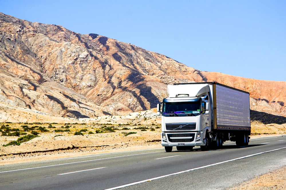 Semi-trailer truck Volvo FH12 at the interurban freeway.