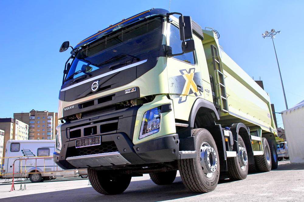 reen Volvo FMX dump truck exhibited at the annual Autosalon Motor show.