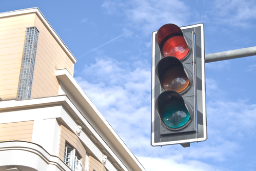 Traffic lights against sky backgrounds