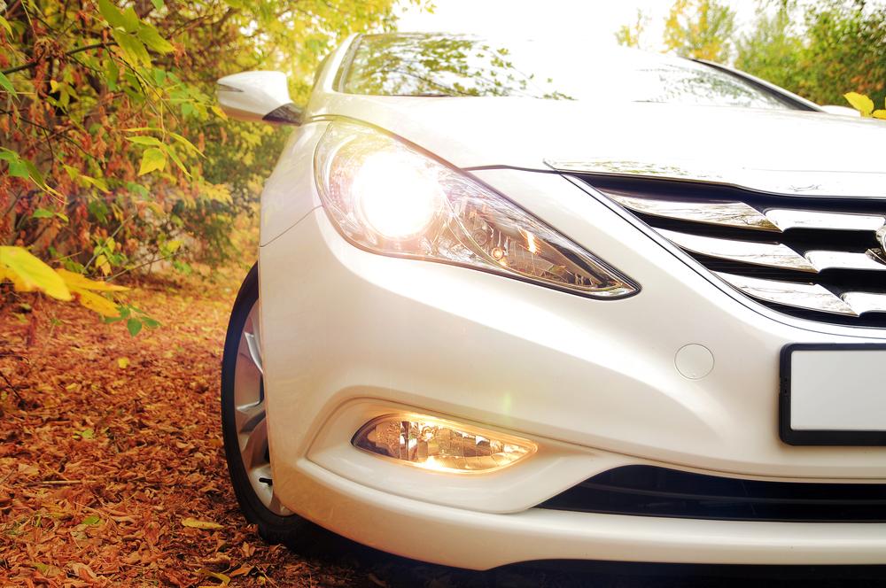 White Hyundai Sonata car front headlamp and headlight with flare