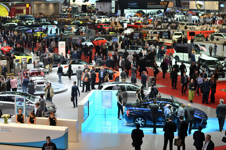 Switzerland, Geneva - March 16, 2017: The visitors (especially journalists and businessmens) looking on the new cars on the motor show. In a few days above 700 000 visitors from 110 countries saw the 900 vehicles from 220 brands on the Geneva Motor Show.