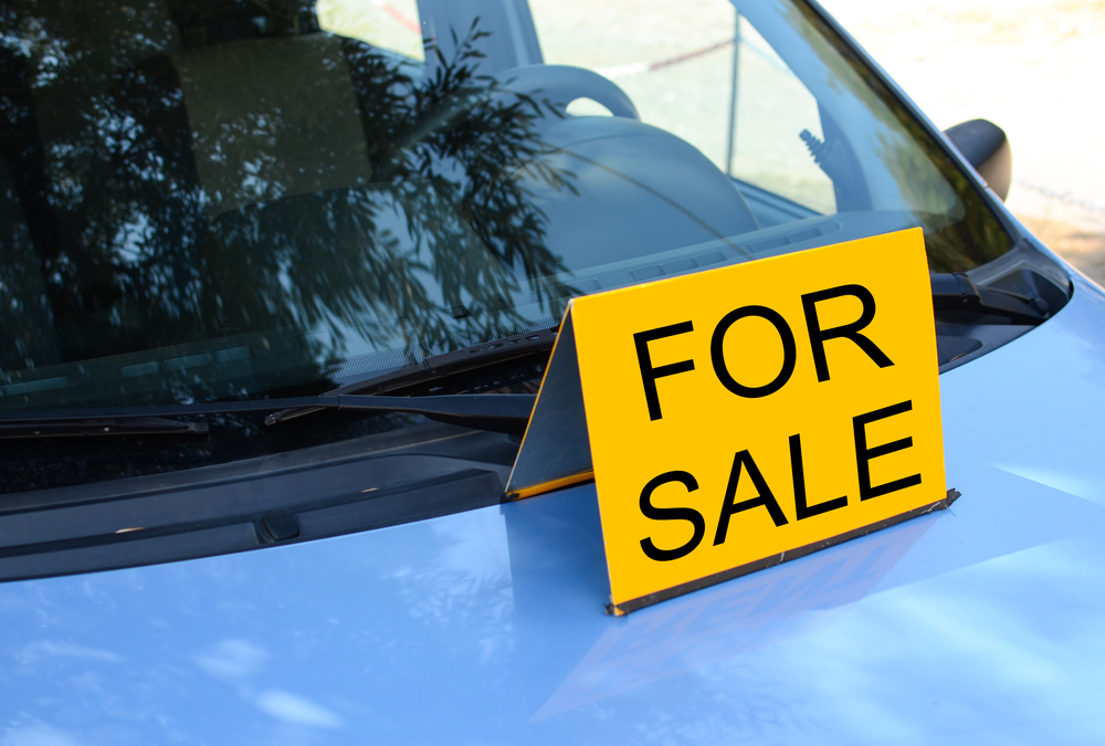 """FOR SALE"" sign on car - Sell a car concept"