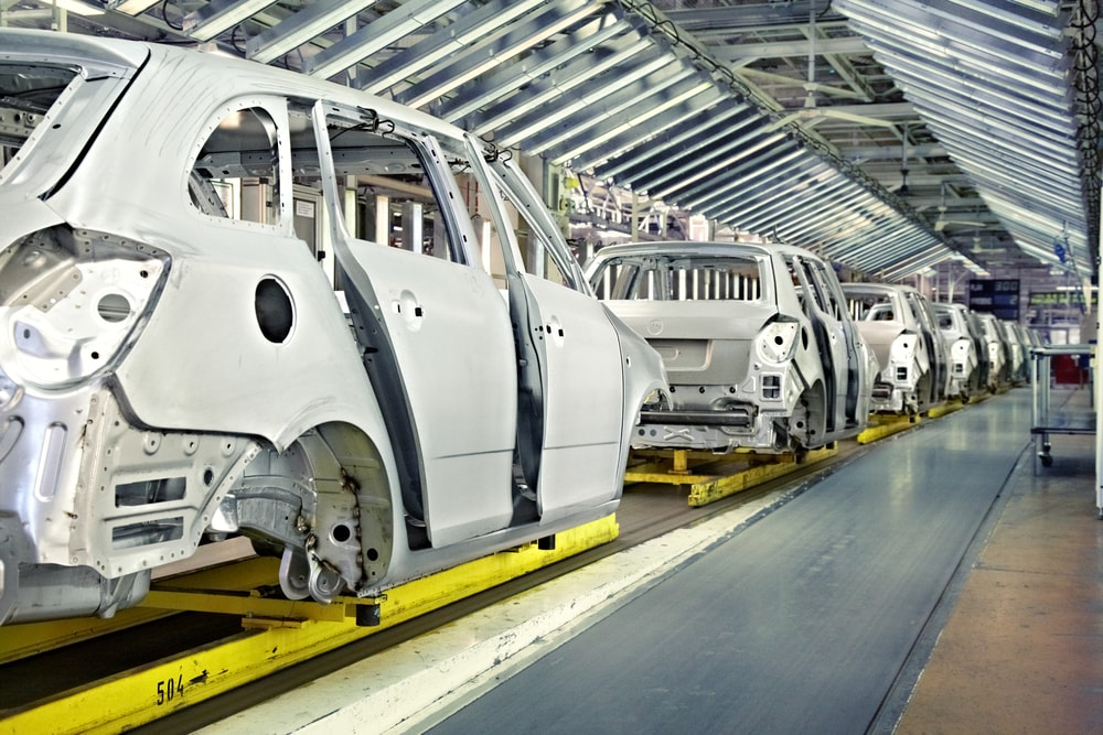cars-on-assembly-line-min