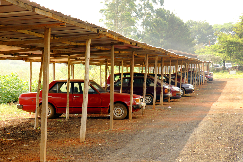Cars parked under the shade of a carport