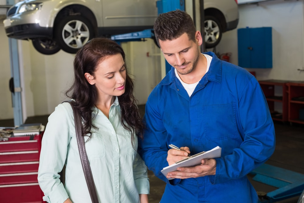 mechanic and customer reviewing