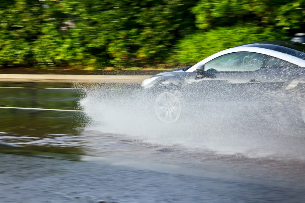 car-hydroplaning-on a flooded street