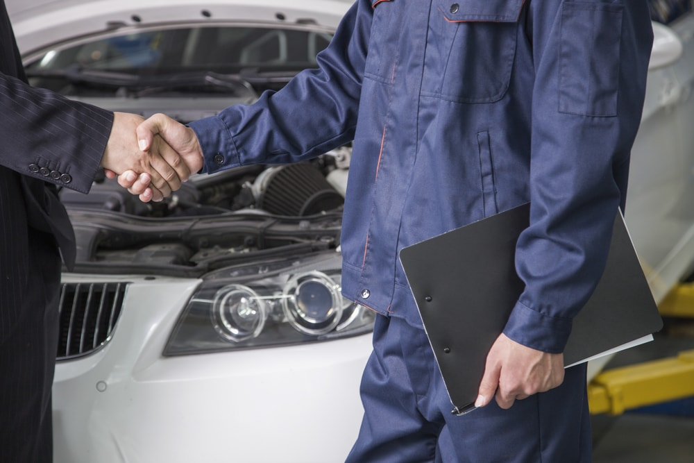 mechanic and businessman negotiate