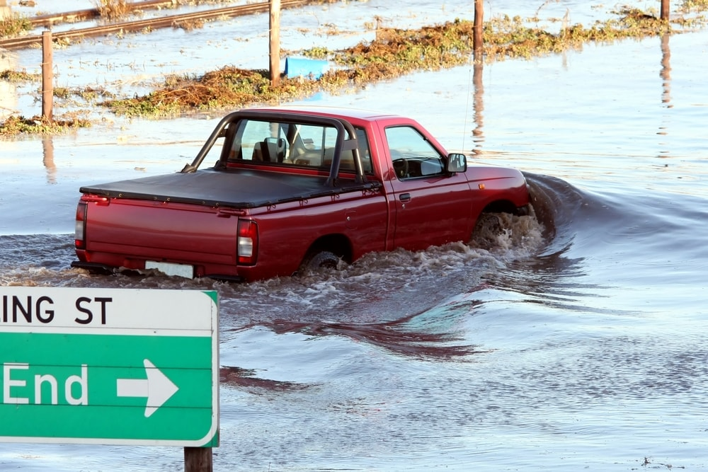 red truck driving through water
